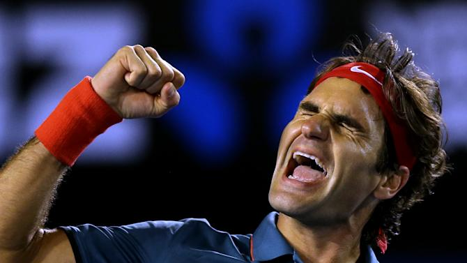 Roger Federer of Switzerland celebrates after defeating Andy Murray of Britain during their quarterfinal at the Australian Open tennis championship in Melbourne, Australia, Wednesday, Jan. 22, 2014