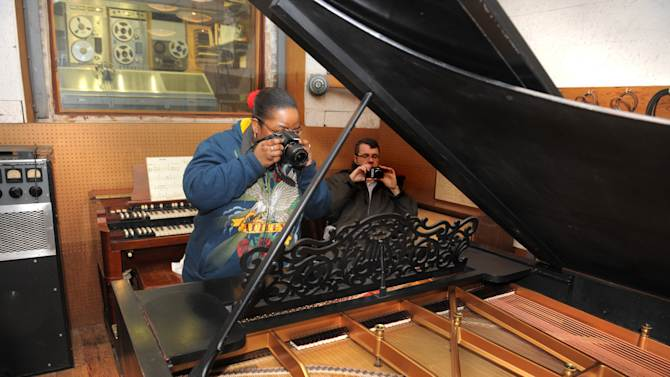 Michael Renee Dozler photographs the famed piano on Monday, April 1, 2013. Detroit's Motown Museum installed its prized Steinway grand piano back into Studio A. (AP Photo/The Detroit News, Max Ortiz)