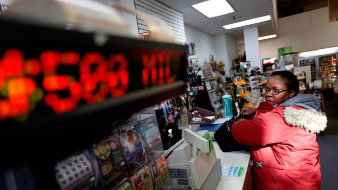 """Pat Powell, 30, of Atlanta, buys a Powerball lottery ticket at a convenience store, Wednesday, Nov. 28, 2012, in Atlanta. """"I think my odds are zero to zero,"""" says Powell """"I don't think I'm going to win but I'll just join the hype. If I did win, I'd open up my own business, an internet café in the West Indies and have a learning center here in Georgia. I'll invest and  try to be as smart with it as I can with it. I will say for the past 3 days, for whatever reason, I've been thinking about winning this money and what I'd do with it. There's no ritual but it's just been on my mind so it's like, let me just join the hype and just do it."""" (AP Photo/David Goldman)"""