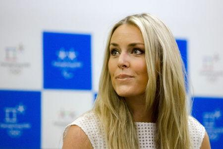 U.S. skier Lindsey Vonn reacts as she is asked about her relationship with golfer Tiger Woods during a news conference in Seoul