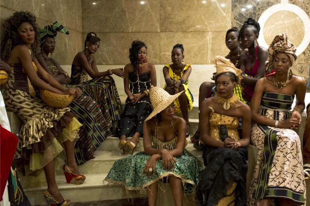 Models wait backstage during a fashion show organized by designer and stylist Sonia Bafonga to celebrate International Women's Day in Bangui