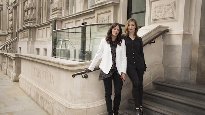 British actresses Jessica Brown Findlay, left, and Holliday Grainger, pose for photographs on the steps of the Corinthia Hotel for The Riot Club photo call, in central London, England, Wednesday, Sept. 10 2014. (Photo by Joel Ryan/Invision/AP)