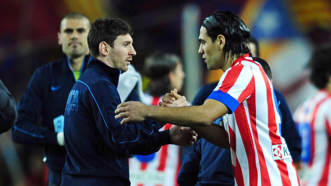 FC Barcelona's Lionel Messi from Argentina, left, shakes hands with Atletico Madrid's Radamel Falcao from Colombia before a Spanish La Liga soccer match at the Camp Nou stadium in Barcelona, Spain, Sunday, Dec.16, 2012. (AP Photo/Manu Fernandez)