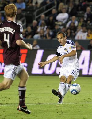 Los Angeles Galaxy forward Landon Donovan, right, kicks the ball in for a goal as Colorado Rapids midfielder Jeff Larentowicz looks on during the first half of their soccer match, Friday, Sept. 9, 2011, in Carson, Calif. (AP Photo/Mark J. Terrill)