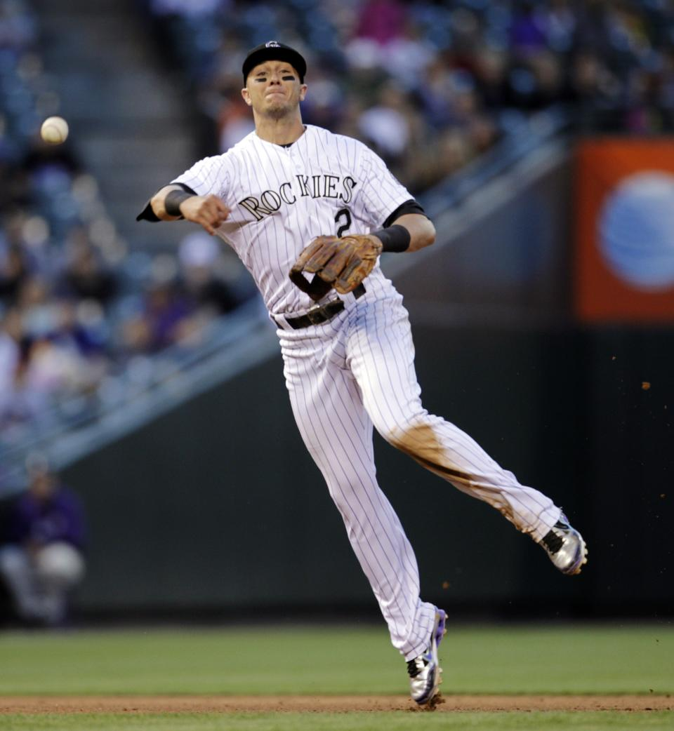 Colorado Rockies shortstop Troy Tulowitzki thows out Houston Astros' Jordan Schafer at first base in the fourth inning of a baseball game, Wednesday, May 30, 2012, in Denver. (AP Photo/Joe Mahoney)