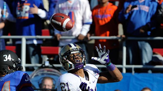 Washington cornerback Marcus Peters breaks up a reception against Boise State Kirby Moore (34) during first half of the MAACO Bowl NCAA college football game on Saturday, Dec. 22, 2012, in Las Vegas. (AP Photo/David Becker)