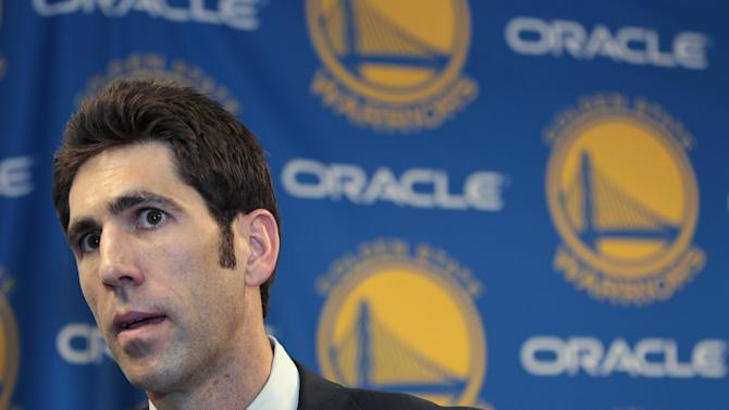 New Golden State Warriors general manager Bob Myers answers questions during a news conference in Oakland, Calif., Tuesday, April 24, 2012. He replaces Larry Riley, who will remain as the team's director of scouting. (AP Photo/Paul Sakuma)
