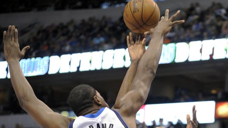 Oklahoma City Thunder forward Kevin Durant (35) shoots over Dallas Mavericks forward Elton Brand (42) in the second quarter of an NBA basketball game, Friday, Jan. 18, 2013, in Dallas. (AP Photo/Matt Strasen)