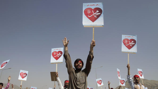 """Afghans hold placards reading: """"Our leader Mohammed"""" during a protest against an anti-Islam film in Kabul, Afghanistan, Thursday, Sept. 20, 2012. (AP Photo/Ahmad Jamshid)"""