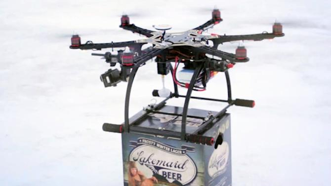 In this Jan. 16, 2014 image from video provided by Lakemaid Beer, a mini-drone lands with a 12-pack of beer for ice fishing anglers on Minnesota's Lake Mille Lacs. Lakemaid president Jack Supple said he thought Amazon's package delivery plan would better be applied on a wide open frozen lake where ice anglers are manning their fishing holes in tiny shanties, but the Federal Aviation Administration heard him talking about his plans on the radio and grounded future deliveries. (AP Photo/Courtesy Lakemaid Beer)