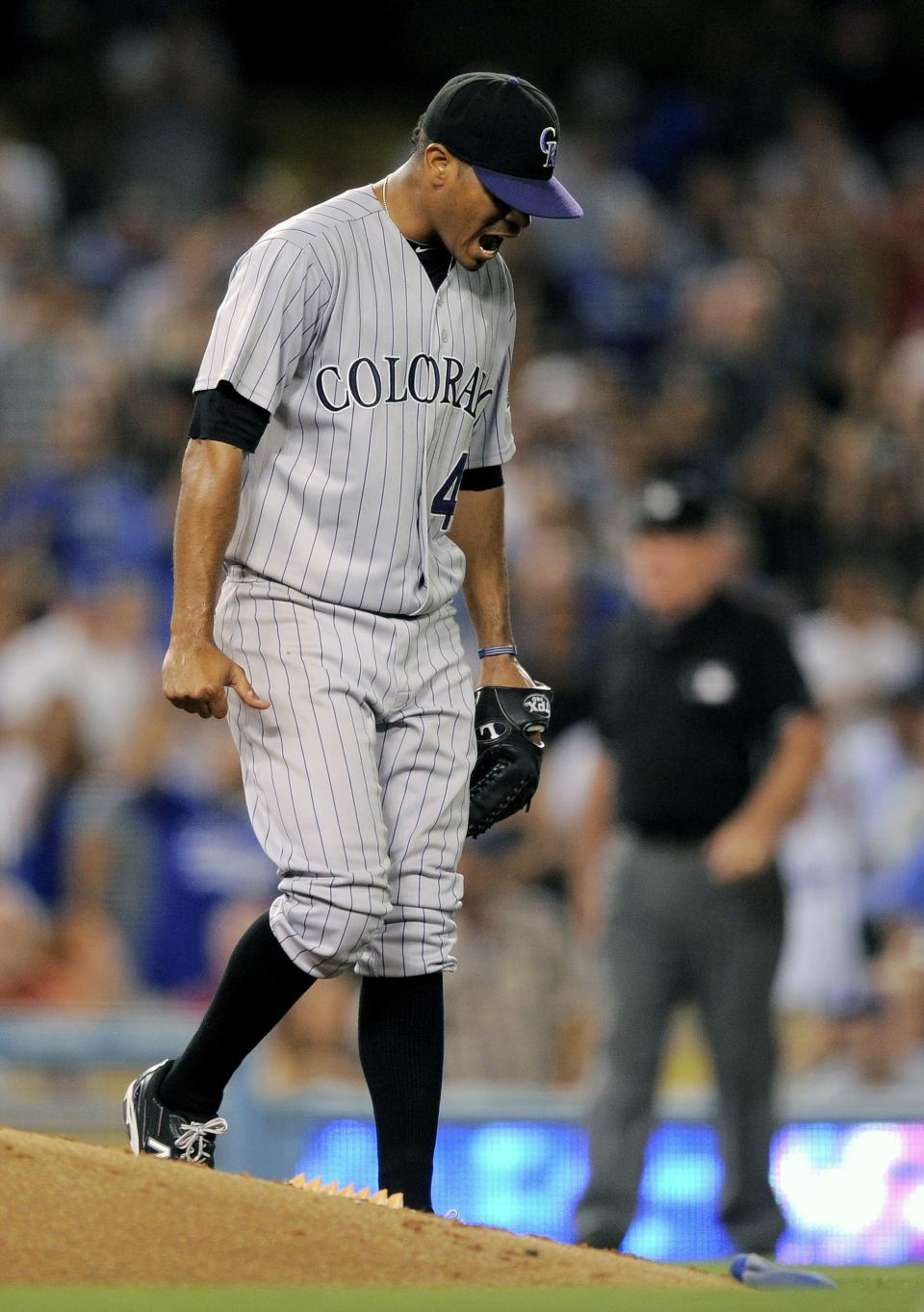 Colorado Rockies starting pitcher Esmil Rogers reacts after being called for a balk with the bases loaded during the seventh inning of their baseball game against the Los Angeles Dodgers, Friday, Aug. 26, 2011, in Los Angeles. (AP Photo/Mark J. Terrill)