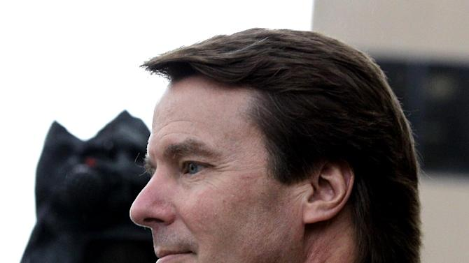 Former presidential candidate and Sen. John Edwards, front, leaves a federal courthouse with his daughter Cate Edwards, back, in Greensboro, N.C., Tuesday, May 8, 2012. Edwards is accused of conspiring to secretly obtain more than $900,000 from two wealthy supporters to hide his extramarital affair with Rielle Hunter and her pregnancy. He has pleaded not guilty to six charges related to violations of campaign-finance laws. (AP Photo/Chuck Burton)