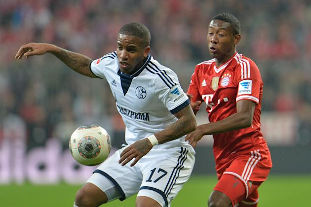 Bayern's David Alaba of Austria, right, and Schalke's Jerome Boateng challenge for control during the German first division Bundesliga soccer match between FC Bayern Munich and FC Schalke in M