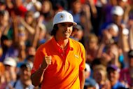 Rickie Fowler of the United States celebrates after making a putt for birdie on the first playoff hole to defeat Rory McIlroy of Northern Ireland and D.A. Points of the United States during the final round, to win the Wells Fargo Championship at the Quail Hollow Club in Charlotte, North Carolina