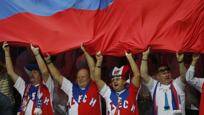 Czech Republic's fans cheer for Tomas Berdych and Radek Stepanek during their tennis Davis Cup final doubles match against Spain's Marcel Granollers and Marc Lopez in Prague, Czech Republic, Saturday, Nov. 17, 2012. (AP Photo/Petr David Josek)