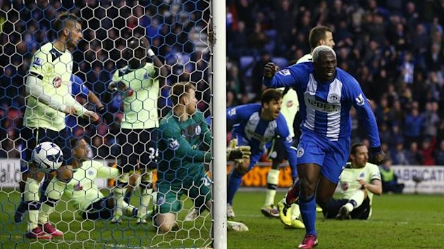 Wigan Athletic&#39;s Arouna Kone (R) celebrates his goal against Newcastle United during their English Premier Leagu