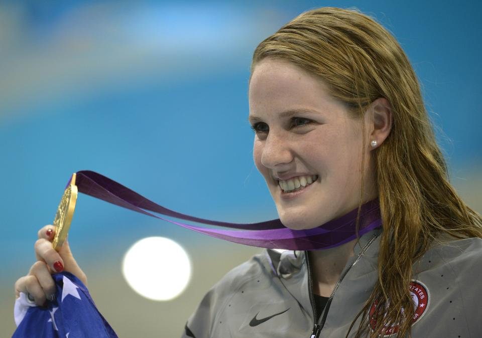 United States' Missy Franklin poses with her gold medal for the women's 100-meter backstroke swimming final at the Aquatics Centre in the Olympic Park during the 2012 Summer Olympics in London, Monday, July 30, 2012. (AP Photo/Mark J. Terrill)