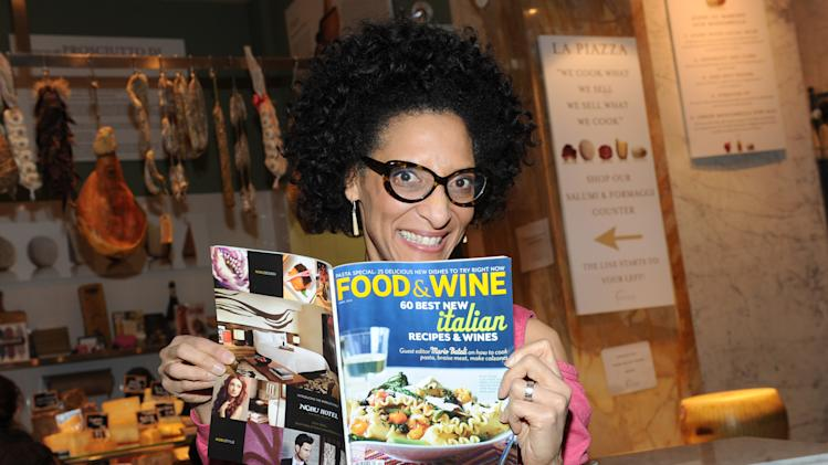IMAGE DISTRIBUTED FOR FOOD & WINE - Carla Hall, of The Chew, helps celebrate her co-host Mario Batali's stint as guest editor of the April issue of FOOD & WINE during a party at Eataly, Wednesday, March 6, 2013, in New York.  (Photo by Diane Bondareff/Invision for FOOD & WINE/AP Images)