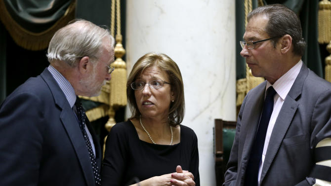 Rhode Island Senate President Teresa Paiva Weed, center, and Senate Majority Leader Dominick Ruggerio, right, speak with Senate Parliamentarian John Roney, left, before going into session in the Senate Chamber at the Statehouse, in Providence, R.I., Wednesday, April 24, 2013. Paiva Weed and Ruggerio both voted against a same-sex marriage bill that passed in the R.I. Senate Wednesday. (AP Photo/Steven Senne)