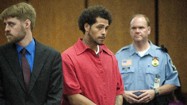 Carlos Ortiz, center, is shown during a hearing in court in Bristol, Conn., Friday, June 28, 2013. New Britain State's attorney says investigators arrested the 27-year-old Ortiz in Bristol on Wednesday in connection with the murder case against former New England Patriots tight end Aaron Hernandez. A judge ordered Ortiz turned over to Massachusetts authorities during the hearing. (AP Photo/The Bristol Press, Mike Orazzi, Pool)