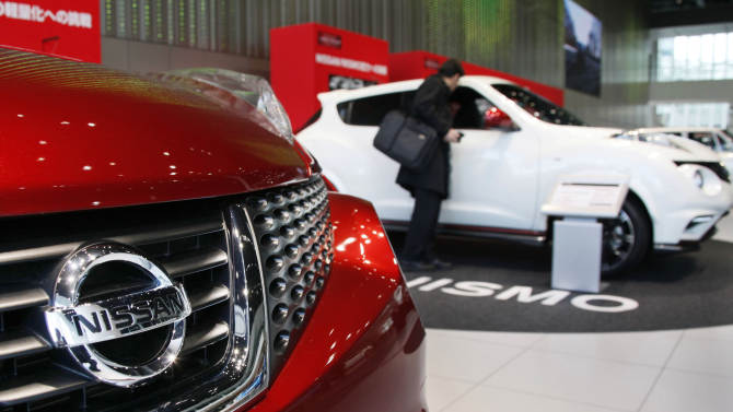 A visitor inspects a Nissan SUV at a gallery inside the headquarters of Nissan Motor Co. in Yokohama, Japan, Friday, Feb. 8, 2013. The Japanese auto maker suffered a 34.6 percent plunge in October-December profit to 54.1 billion yen (US$579 million) as global sales languished, especially in China, where anti-Japanese sentiment flared over a territorial dispute. (AP Photo/Koji Sasahara)