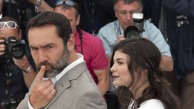 Actor Gilles Lellouche, left, and Audrey Tautou pose during a photo call for Therese Desqueyroux at the 65th international film festival, in Cannes, southern France, Sunday, May 27, 2012. (AP Photo/Jonathan Short)
