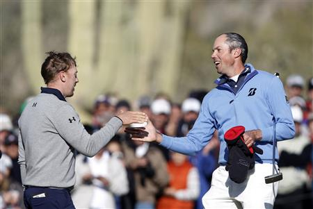 Golfer Kuchar shakes hands with Mahan after Kuchar won the championship match of the WGC-Accenture Match Play Championship golf tournament in Marana