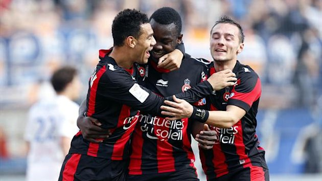 Nice's French forward Stephane Bahoken (C) celebrates after scoring a second goal with Nice's French defender Thimothee Kolodziejczak (L) and Nice's French forward Eric Bautheac (AFP)