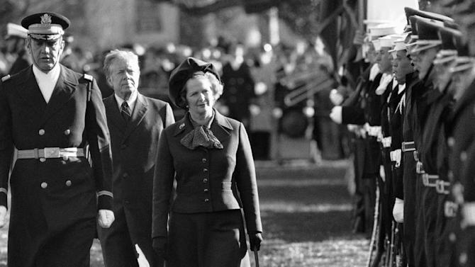 """FILE - In this Dec. 17, 1979 file photo, British Prime Minister Margaret Thatcher  reviews the honor guard at the White House in Washington, as President Jimmy Carter follows.  At left in Col. Stanley Bonta, commander of the guard. Ex-spokesman Tim Bell says that Thatcher has died. She was 87. Bell said the woman known to friends and foes as """"the Iron Lady"""" passed away Monday morning, April 8, 2013. (AP Photo/File)"""