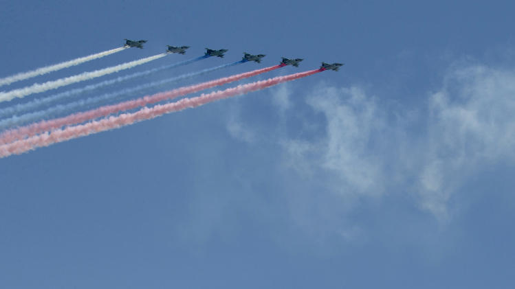 Russian army aircraft fly over the Kremlin during a Victory Day Parade at Moscow's Red Square, in Russia, Thursday, May 9, 2013. (AP Photo/Misha Japaridze)