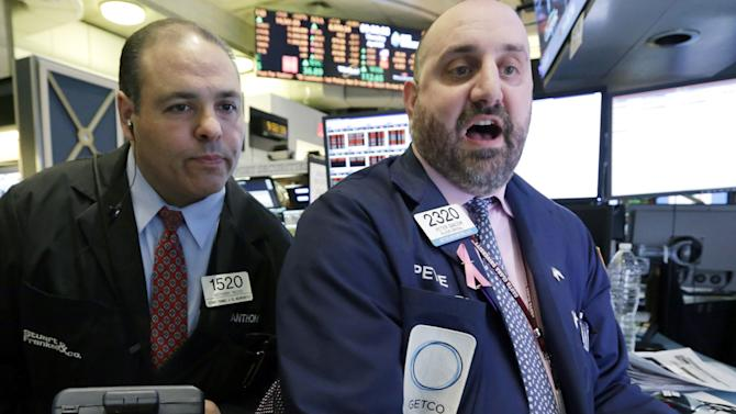 In this Thursday, April 4, 2013, photo, trader Anthony Riccio, left, and specialist Peter Giacchi work on the floor of the New York Stock Exchange. Stocks dropped sharply on Wall Street, Friday, April 5, 2013, after the government reported that U.S. employers added the fewest jobs in nine months in March and more people gave up looking for work. The report was worse than economists were expecting. (AP Photo/Richard Drew)