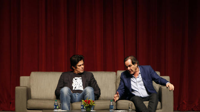 "Puerto Rican actor Benicio Del Toro, left, and film director Oliver Stone talk during a conference with students at the University of Puerto Rico in San Juan, Friday, Nov. 30, 2012. Del Toro didn't wait long to collect on a favor that Stone owed him for working extra hours on the set of his most recent movie, ""Savages"", released this year: a trip to his native Puerto Rico, which Stone hadn't visited since the early 1960s.  Both are in the U.S. Caribbean territory to raise money for the Art Museum of Puerto Rico, which is hosting its annual movie festival and will honor Stone's movies. (AP Photo/Ricardo Arduengo)"