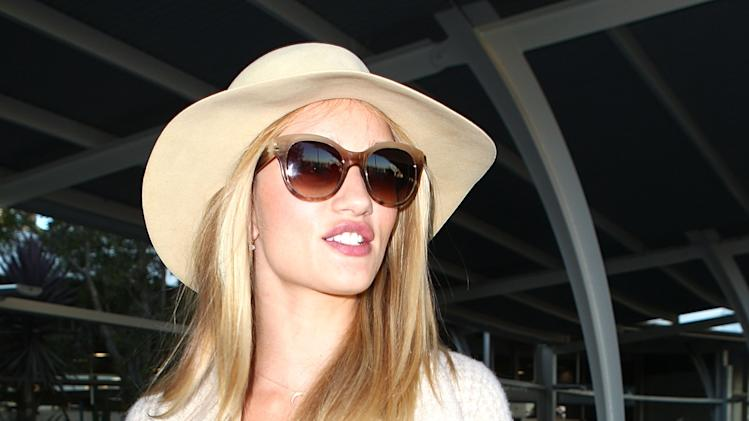 Rosie Huntington-Whiteley Arrives In Australia