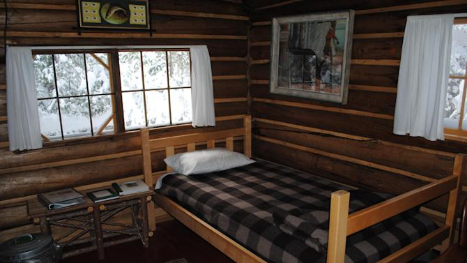 This December 2012 photo shows the interior of a rustic cabin at the Appalachian Mountain Club's Little Lyford Lodge and Cabins, a backcountry wilderness lodge near Greenville, Maine. The cabin has no electricity, is heated by a wood stove and lit by gas lamp. In winter, visitors can reach the lodges and cabins only by cross-country skiing in.  (AP Photo/Lynn Dombek)