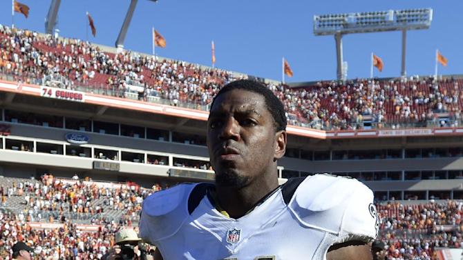 New Orleans Saints linebacker Jonathan Vilma (51) leaves the field after this team defeated the Tampa Bay Buccaneers 35-28 in an NFL football game on Sunday, Oct. 21, 2012, in Tampa, Fla. (AP Photo/ Phelan Ebenhack)
