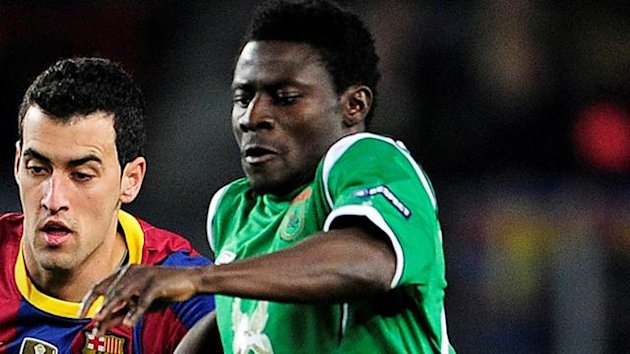 FOOTBALL Obafemi Martins of Rubin Kazan vying with Sergio Busquets of Barcelona in a Champions League match