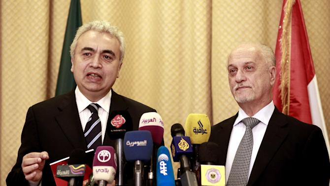 Hussein al-Shahristani, deputy Prime Minister for Energy, right, listens as Chief Economist of the IEA Fatih Birol, left, speaks during a press conference in Baghdad, Iraq, Wednesday, Oct. 10, 2012, Iraq's top energy official is predicting that the country's current oil production of 3.4 million barrels per day will double by 2015. (AP Photo/Hadi Mizban)