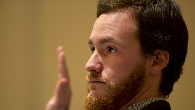 Daniel Cleveland, Third Mate of the Bounty, is sworn in before the start of a hearing into the sinking of the HMS Bounty Friday, Feb. 15, 2013 at the Renaissance Portsmouth Hotel and Waterfront Conference Center in Portsmouth, Va. Sixteen people were aboard the ship when it sank. Crew member Claudene Christian, 42, died, and Capt. Robin Walbridge, 63, was never found. (AP Photo/The Virginian-Pilot, The' N. Pham, Pool)