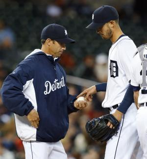 Detroit Tigers manager Brad Ausmus takes the ball from pitcher Rick Porcello against the Houston Astros in the seventh inning of a baseball game in Detroit, Wednesday, May 7, 2014. (AP Photo/Paul Sancya)