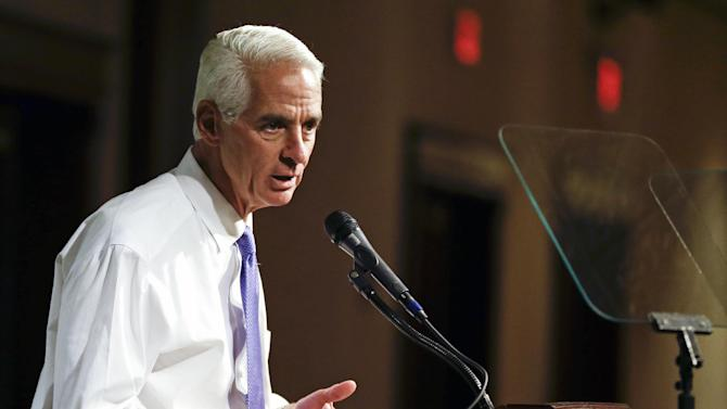 "FILE -This May 21, 2014 file photo shows Florida Democratic gubernatorial candidate Charlie Crist campaigning in Orlando, Fla. Recently, campaigning in Miami's Little Havana, Crist stood before a crowd and said what few politicians have in decades of scrounging for votes in the Cuban-American neighborhood: end the trade embargo against Cuba. ""If you really care about people on the island, we need to get rid of the embargo and let freedom reign,"" he said, shouting above a small band of protesters who responded with chants of ""Shame on you!"" Crist's supporters cheered louder. (AP Photo/John Raoux, File)"