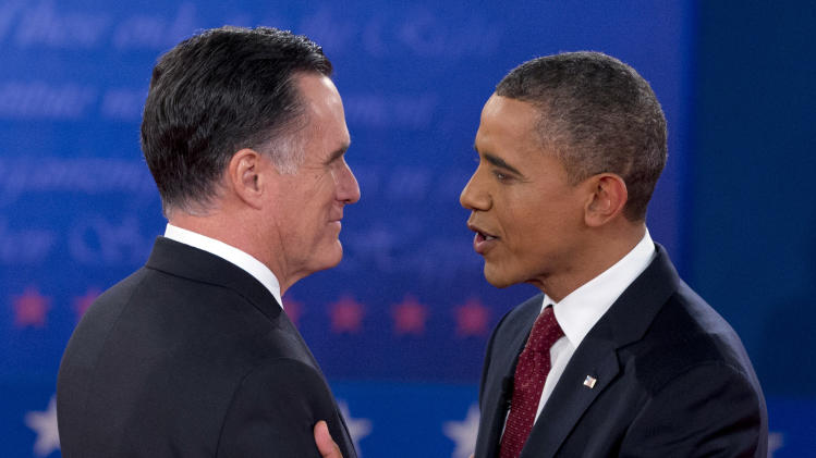 President Barack Obama and Republican presidential candidate, former Massachusetts Gov. Mitt Romney, greet each other as they arrive for the second presidential debate, Tuesday, Oct. 16, 2012, at Hofstra University in Hempstead, N.Y. (AP Photo/Carolyn Kaster)