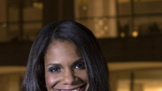 """In this photo provided by """"Live from Lincoln Center,"""" Broadway star Audra McDonald poses for a portrait in front of the Lincoln Center in New York. PBS said Tuesday, Nov. 27, 2012, that the singer-actress is the new host of """"Live from Lincoln Center."""" McDonald will emcee seven broadcasts from December through spring 2013, starting Dec. 13 with """"The Richard Tucker Opera Gala."""" (AP Photo/Live from Lincoln Center, Chase Newhart)"""