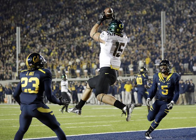 Oregon tight end Colt Lyerla (15) grabs a ten yard touchdown pass in front of California defensive back Josh Hill (23) and defensive back Michael Lowe (5) during the first half of an NCAA college foot