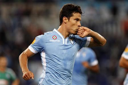 Lazio's Hernanes celebrates after scoring against Legia Warsaw during their Europa League soccer match in Rome