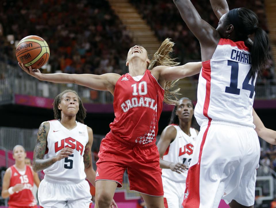 Croatia's Iva Ciglar (10) is fouled by USA's Tina Charles (14) during the second half of a preliminary women's basketball game at the 2012 Summer Olympics, Saturday, July 28, 2012, in London. USA's Seimone Augustus (5) is at left. (AP Photo/Eric Gay)
