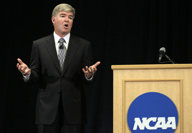 NCAA President Mark Emmert gestures during a news conference in Indianapolis, Monday, July 23, 2012. The NCAA has slammed Penn State with an unprecedented series of penalties, including a $60 million