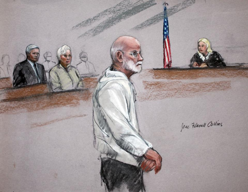 "In this courtroom sketch, James ""Whitey"" Bulger stands during his initial appearance in a federal courtroom in Boston Friday, June 24, 2011.  His brother William Bulger, left, and Judge Marianne Bowler, right, are also depicted. (AP Photo/Jane Flavell Collins)"