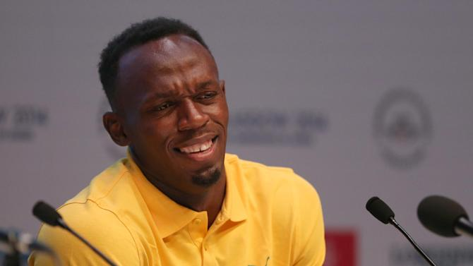 Usain Bolt of Jamaica and double Olympic champion at the 100 and 200 meters puts up his hands after a journalist asked a question at a press conference on the main press centre at the Commonwealth Games Glasgow 2014, in Glasgow, Scotland, Saturday, July, 26, 2014. (AP Photo/Alasatir Grant)