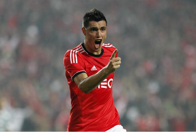Benfica's Oscar Cardozo, from Paraguay celebrates after scoring his second goal against Sporting during a Portugal Cup soccer match between Benfica and Sporting at Benfica's Luz stadium in Lisbon, Sat