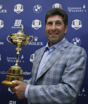 """European Ryder Cup captain José María Olazábal holds the trophy at a  press conference at Heathrow in London Tuesday, Oct. 2, 2012. Olazabal says being European Ryder Cup captain can be """"torture"""" at times and he rules out staying on for another two years in the role. The Spaniard guided Europe to a 14½-13½ victory over the United States in a stirring comeback Sunday in Medinah, Illinois. (AP Photo/Kirsty Wigglesworth)"""